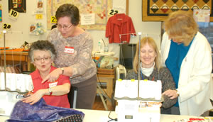 Quilters at Merrily We Quilt Along quilt shop handcrafted more than 5,000 pillowcases for the CAC and other area agencies.